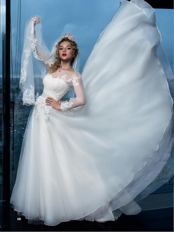 Анастасия Михайлюта примерила белое свадебное платье